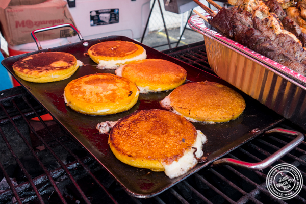 Mozzarepas cooking on a griddle at Chuzos at LIC Flea and Food Market