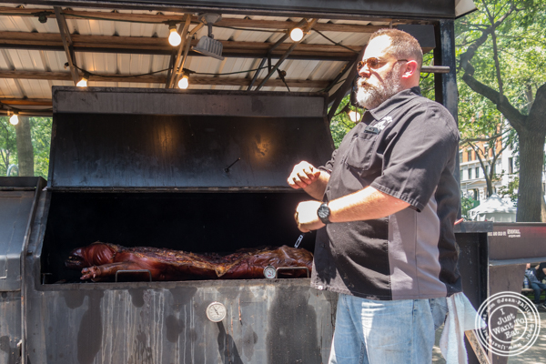 Whole hog cooking in Martin's BBQ Joint's smoker at The Big Apple BBQ Block Party