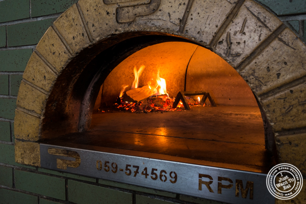 Paves wood-fire burning oven at B Side Pizza Bar in Hell's Kitchen