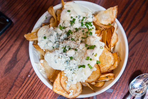 Hot potato chips with cheese fondue at The Smith, Midtown East