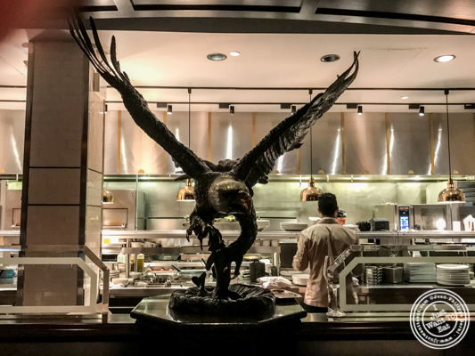 Eagle in front of the open kitchen at The Capital Grille in NYC, NY