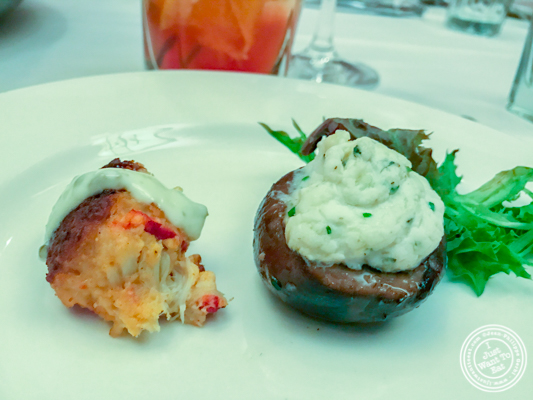 Crab cake bite and stuffed mushroom at The Capital Grille in NYC, NY
