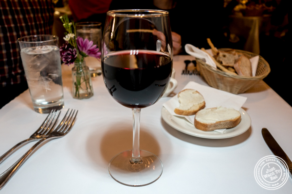 Glass of Pinot Nero 2015 at Bar area at Basta Pasta in Chelsea, NYC