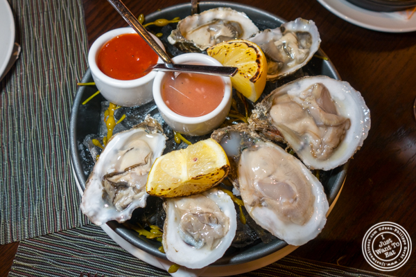 East coast and West coast oysters at Butcher and Banker steakhouse in NYC, NY