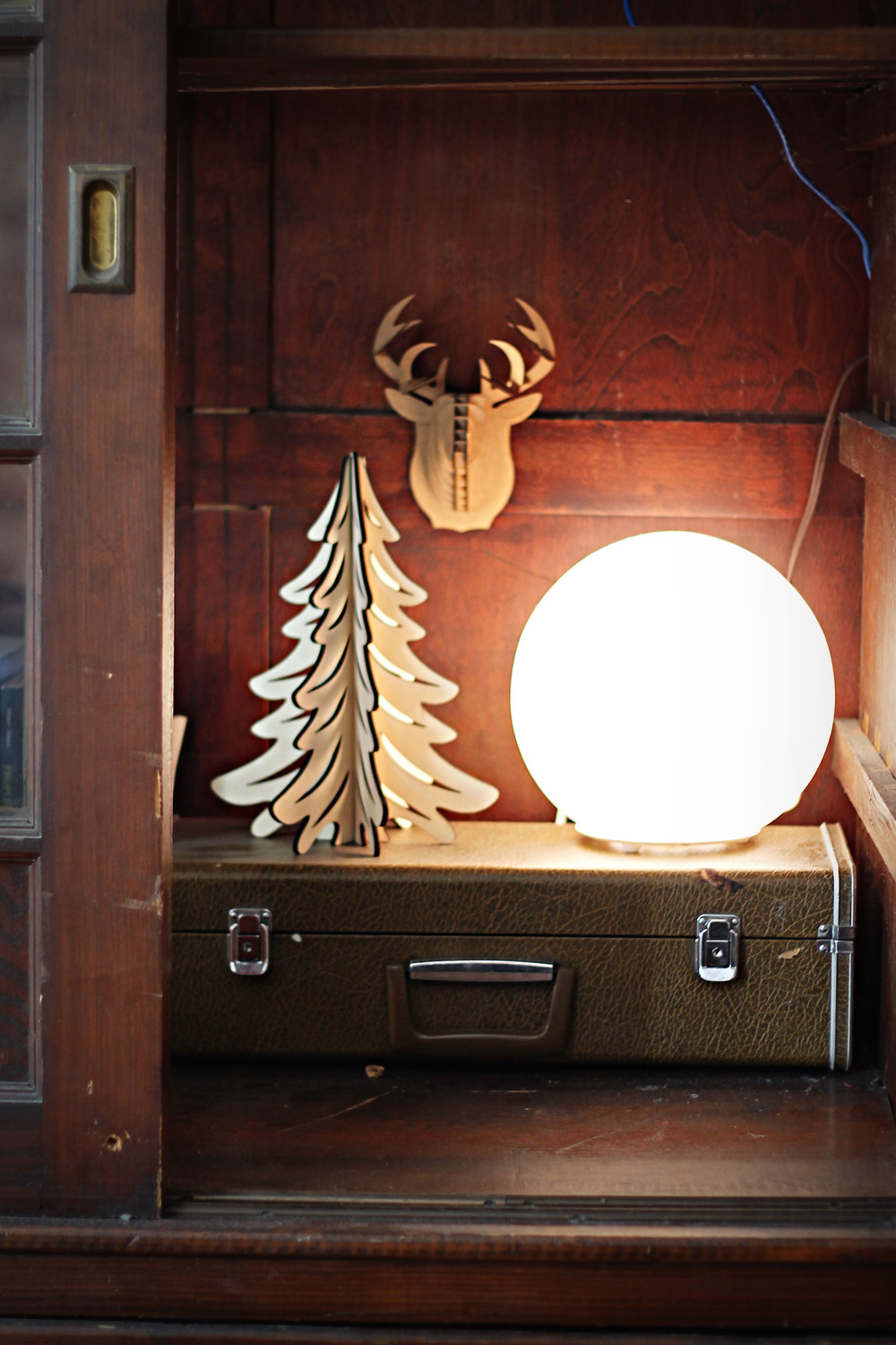 collections like these : matt bought me the lamp as a housewarming gift in my last apartment, our 'christmas tree' that stays year-round, and my granddad's old briefcase.
