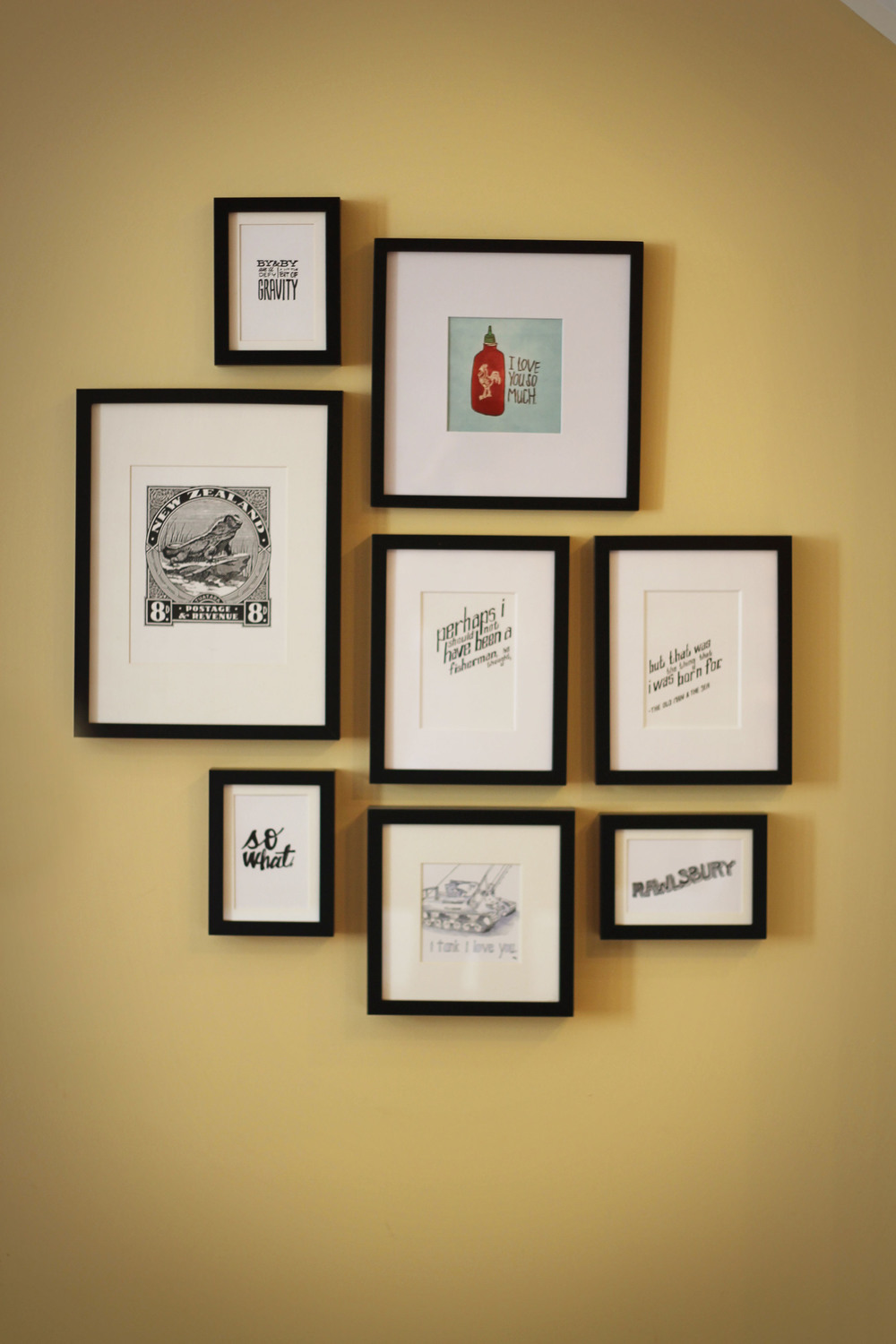 our slowly-growing gallery wall of sketches + prints