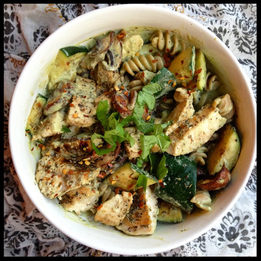 I paired my creamy pesto with half of a serving of whole grain rotini, grilled zucchini, mushrooms and chicken then topped it with red pepper flakes and fresh basil. Yum!