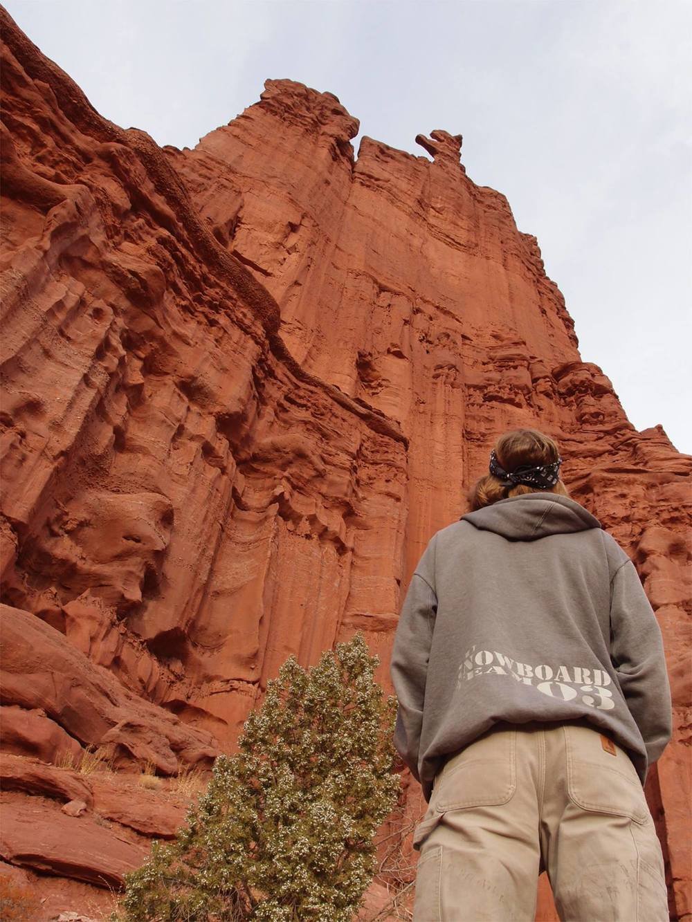 Gazing up at the corkscrew summit of Ancient Art in the Fisher Towers. Ancient Art is one of the smaller pinnacles in the Fishers, approximately a third of the height of the major summits. Photo by Mandi Prout