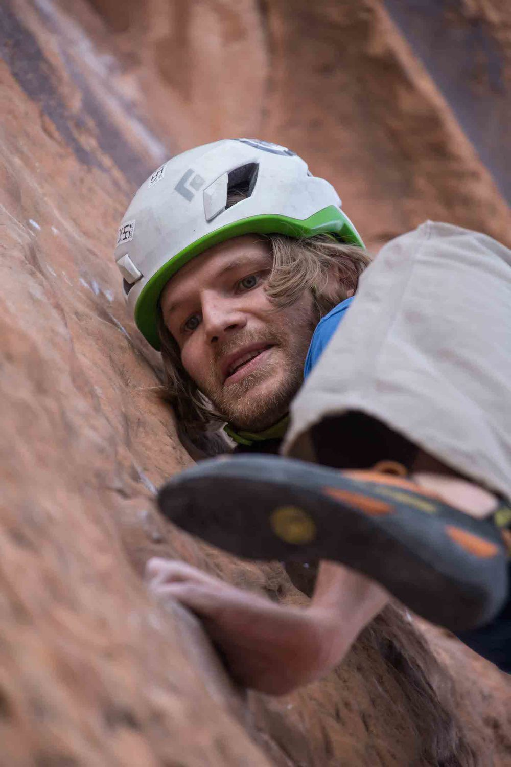 Onsighting  Fistful of Potash  (5.10a) in Moab, five months after surgery. Photo by Gregg Trawinski