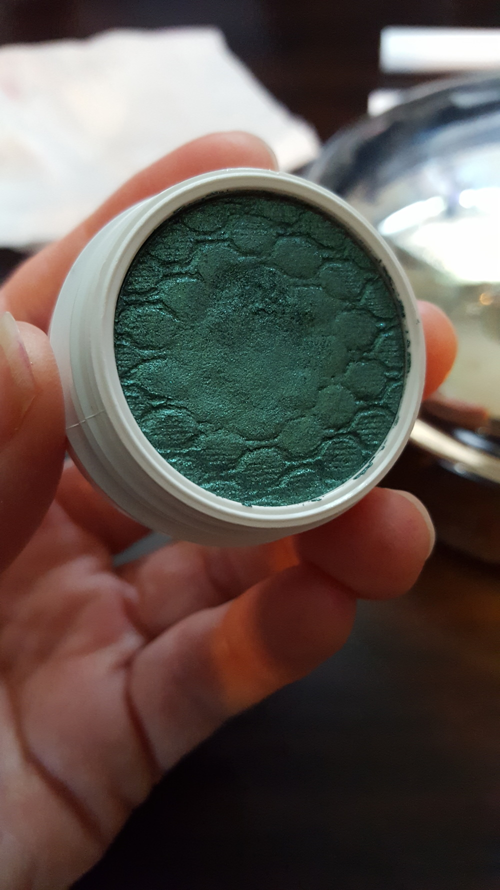 This is an eye shadow in the color Flower Shop. All the powder products come in individual pots and are stamped with the same quilted pattern.