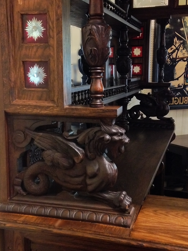 Carved Griffin on an English Pub Bar