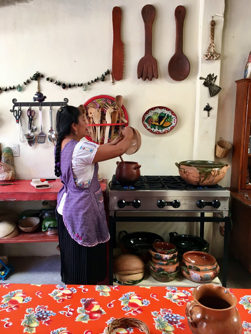 Reyna preparing nicuatole, a slightly sweet corn thickened dessert.
