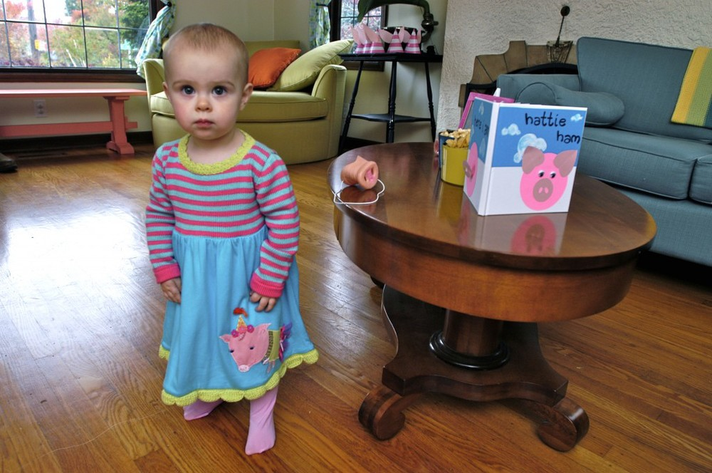 The piglet of the party! The birthday girl in her pretty piggy party dress.