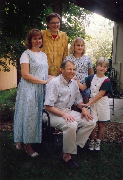 Me (pictured right) with my family c.1997