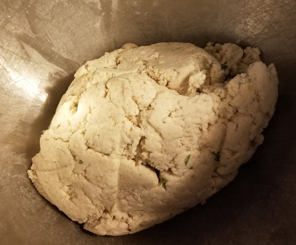 Dough should stay together in a ball. It it doesn't, add more rice flour.