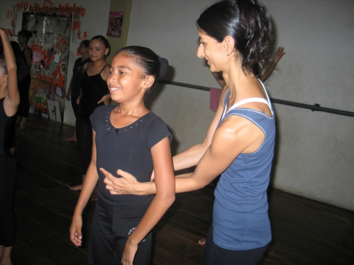 Sameena working with a young dancer in Managua