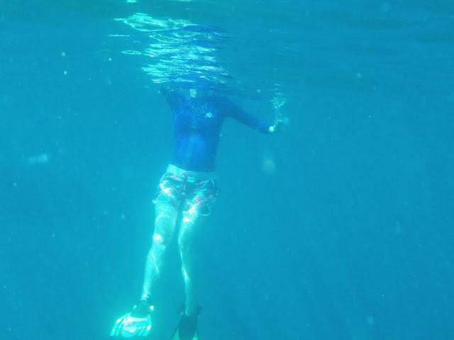 snorkeling on coral reefs off Ao Nang Beach