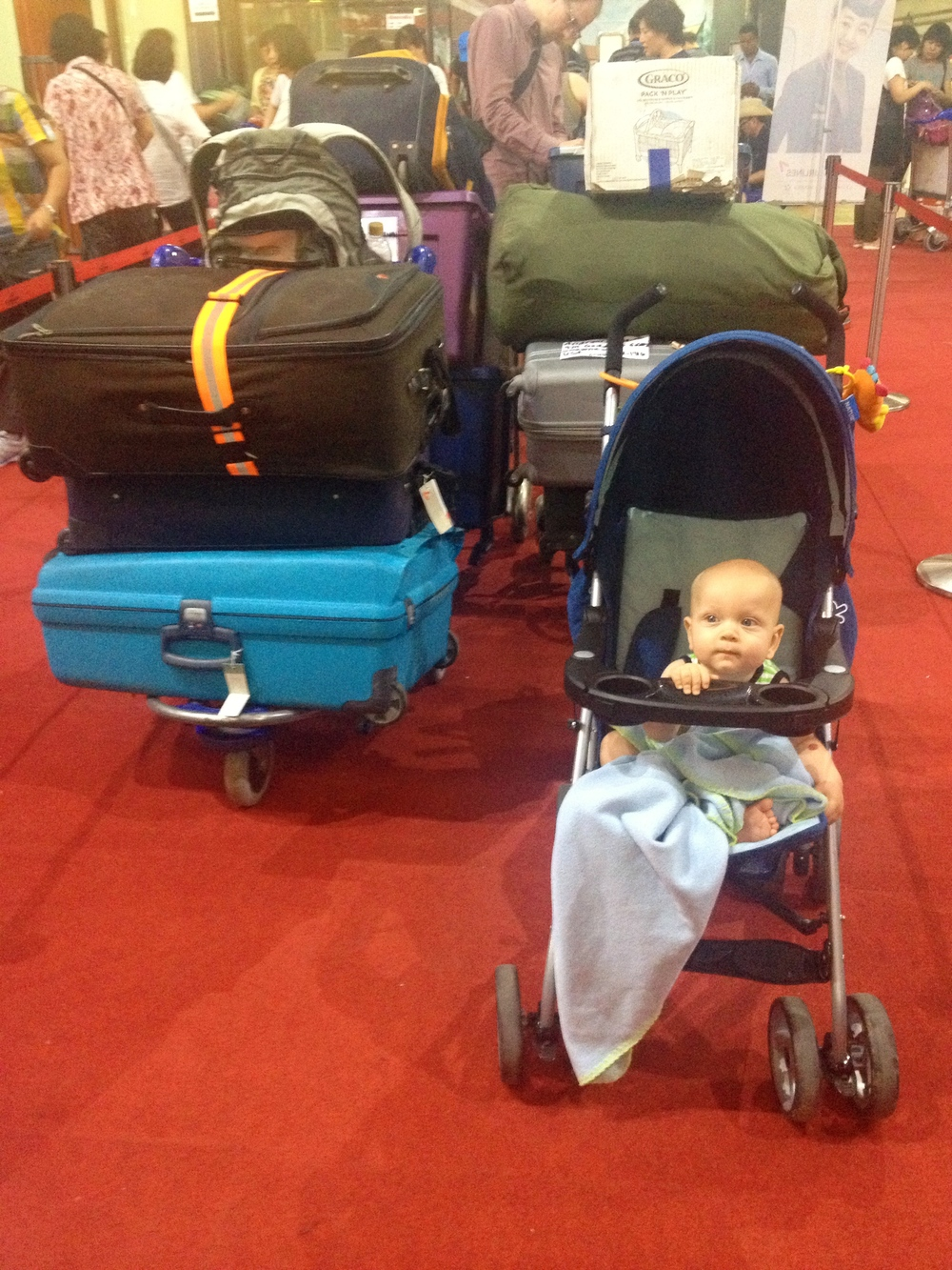 Declan hanging out at the Siem Reap Airport, watching his mother lose her mind.