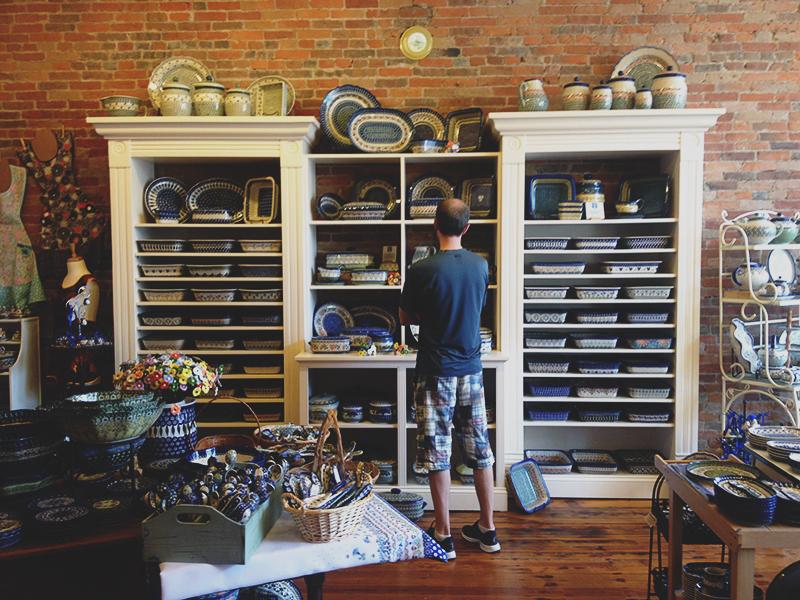 Andrew examining the goods inside the polish pottery shop