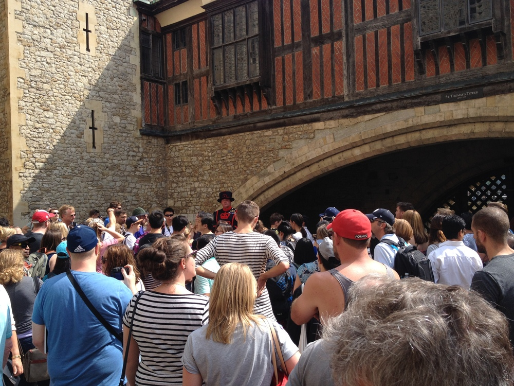 A sea of tourists and one brave Beefeater