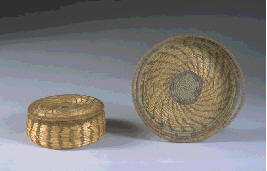 The photograph above is of sweet grass and raffia baskets made by the Pocumtuck Basket Makers (part of the Arts and Crafts movement) in the 1900s, after the style of Native American baskets.