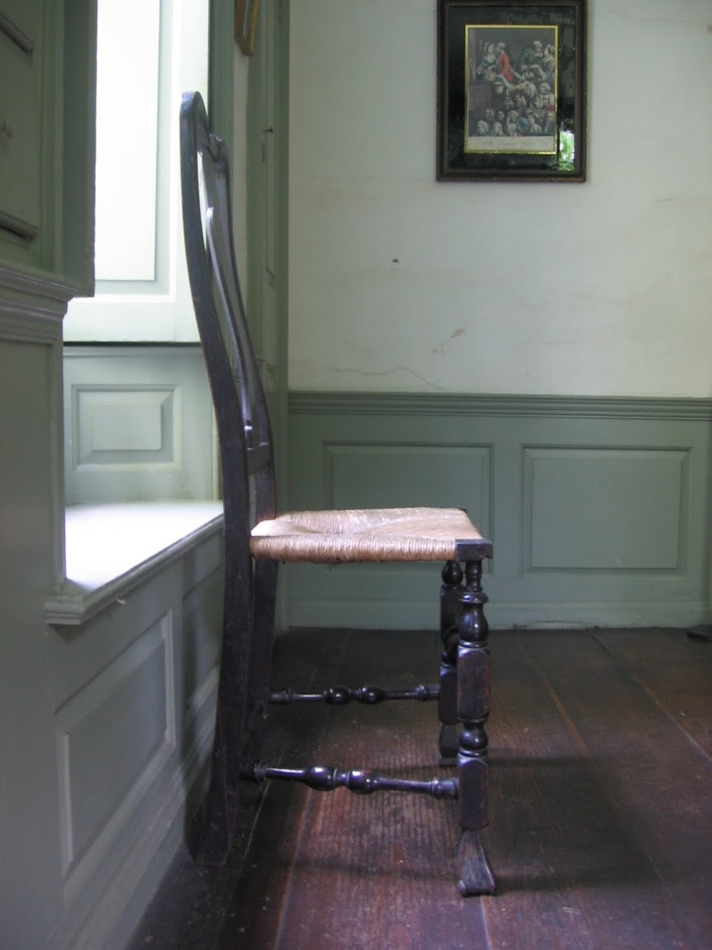 One of the chairs described below against paneling installed by Gaylord in 1775 in the Long Room.