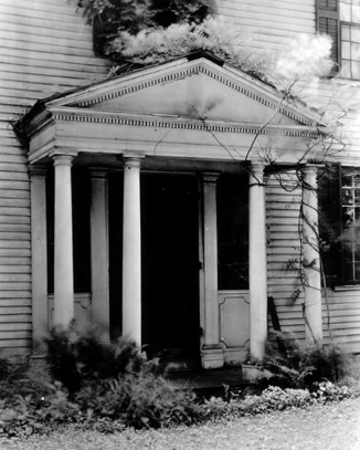 In 1921, the house was falling into disrepair. Notice the plants growing right out of the roof.