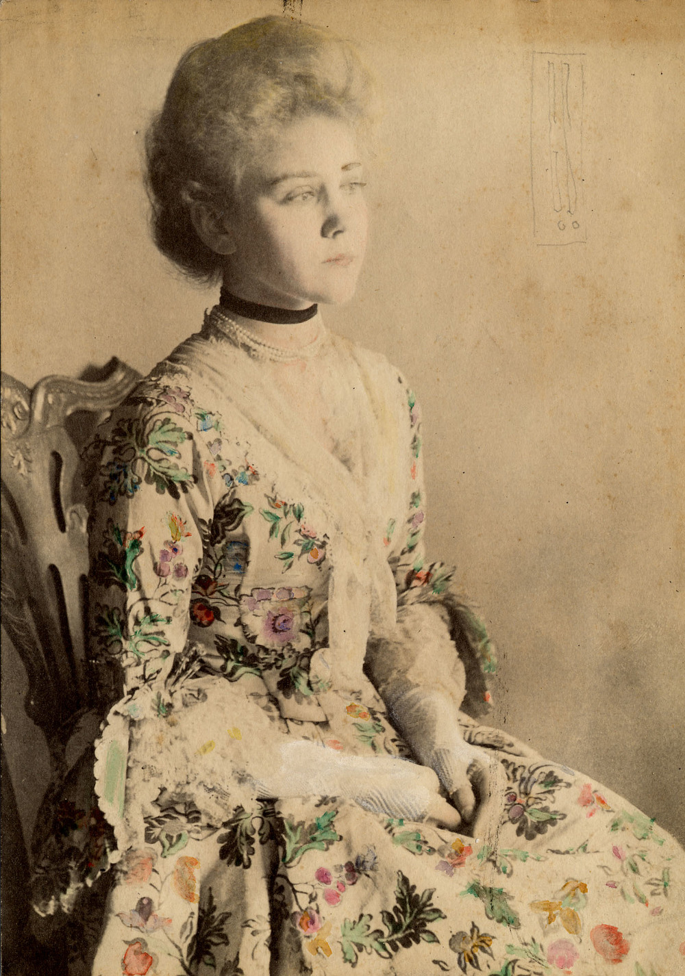 Catharine Huntington (1887-1987)  (pictured here) also wore Elizabeth Pitkin's wedding dress. This black and white photograph has been hand-colored to indicate how it would have looked when Catharine wore it around the start of the 20th century.