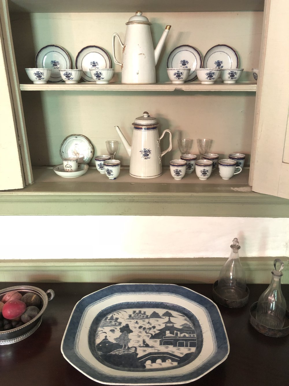 The china cabinet, with the platter below (Accession Number C014.C)