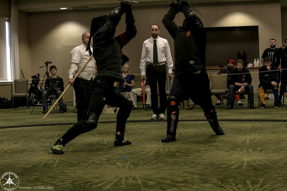 I'm the guy in the white vest that you sometimes see photobombing the fencers you're trying to take a picture of.