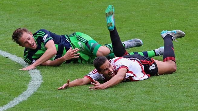 Jack Rodwell (Sunderland) y Gylfi Sigurdsson [Fotografía: Sunderland AFC]