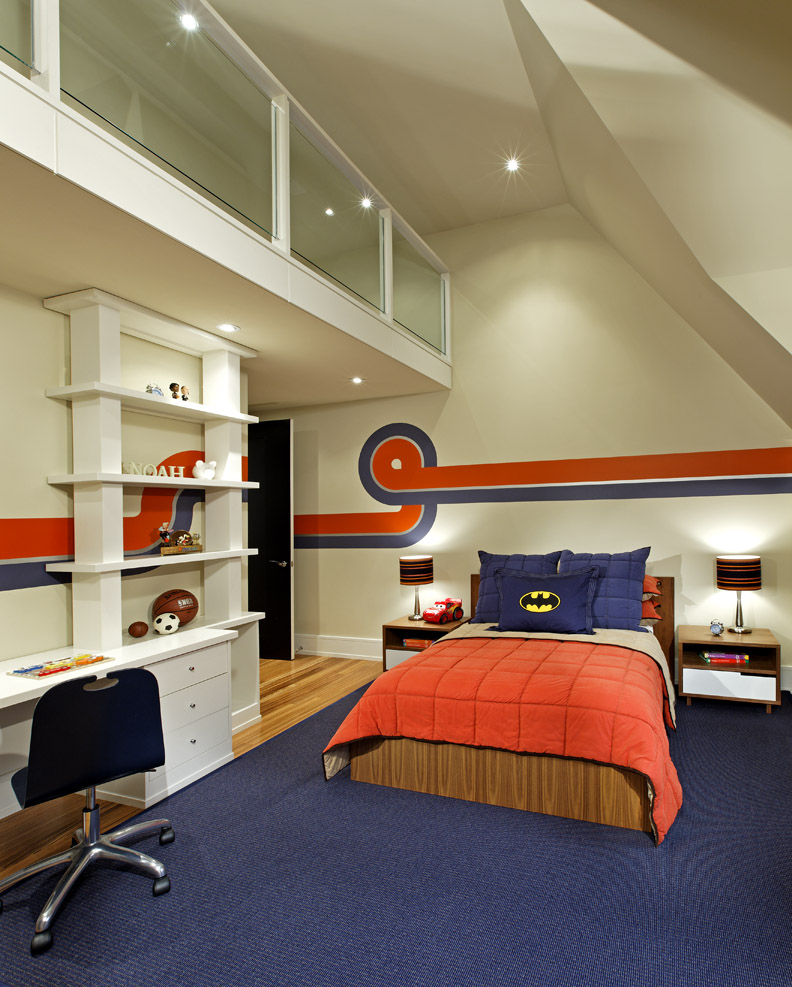 With a traditionally styled house, a clean, open and contemporary interior responds to his young family's modern tastes. Below this room's loft play area there's plenty of storage for clothes and toys, all surrounded by a racing super graphics theme in the 4 year-old boy's favourite sports teams' colours.