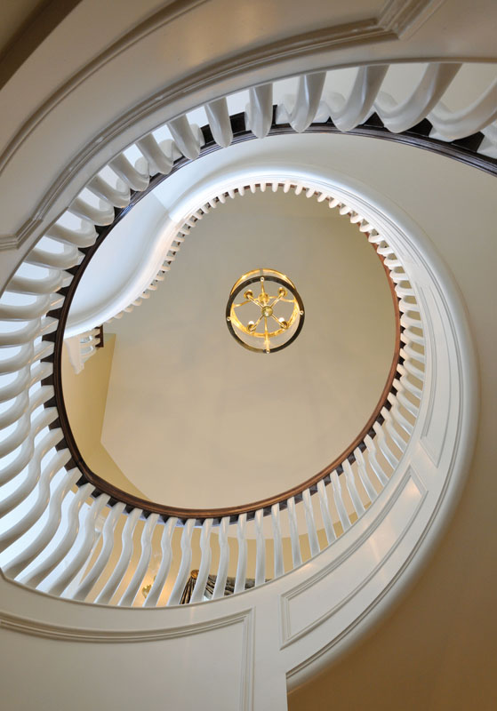 "We designed this classic, spacious and comfortable ""farmhouse"", situated on rolling acres of farm and woodland in Upper New York State, to serve the family for years to come. This remarkable sculptural staircase exemplifies the exquisite detailing throughout."