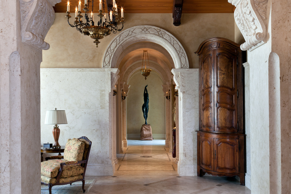 Although most of the furnishings were provided by a local decorator, Lisa Kahn, with whom we worked closely, we sourced certain special pieces, such as a pair of extraordinary Lyonnais walnut cured door encoignures c.1780 found in France. These 10 foot tall units were positioned in the corners of the entry from the living room to the covered loggia. Their shape softens the corners of the room and their detailing works well with the intricately detailed stonework we designed.