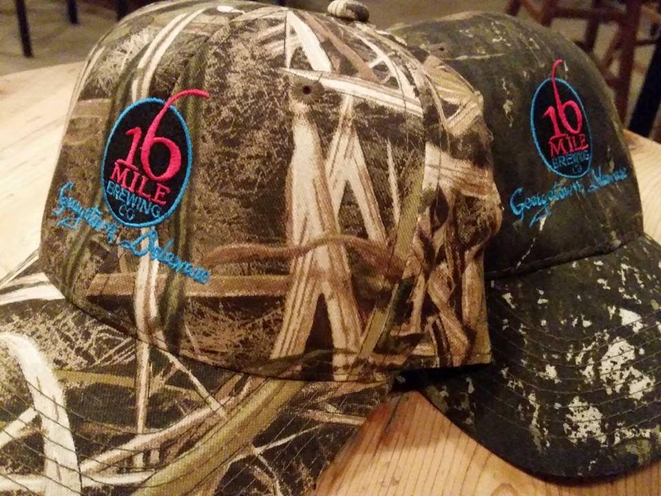b9476101fff07 16 Mile Brewing has a few new items in stock including this camo logo hat.  The brewery has newly redesigned growlers that you can fill with your  holiday ...
