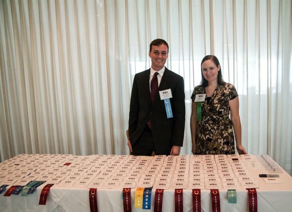 Two of our volunteers breaking for a photo at our Alabama International Business Awards event!