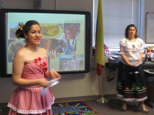 Volunteer presenters, Andrea Lancheros Triana Hyde and Alejandra Bowlin, share the culture of their home, Colombia, at the Professional Development Workshop.
