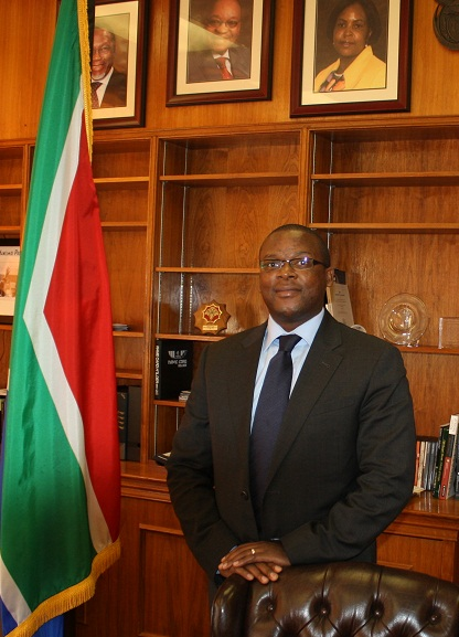 Johnny Moloto, Deputy Chief of Mission at the South African Embassy, attends a reception at BIC held in his honor.