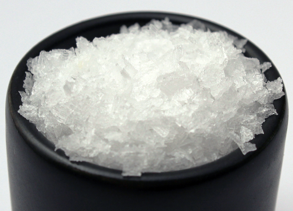 Flake Salt Flake salt comes in two varieties: paper-thin flakes or pyramid-shaped crystals. Both result from evaporating seawater and then bringing the brine to a slow boil until the snowflake-like crystals form. Being both fast dissolving and pleasantly crunchy, flake salt makes an excellent finish for vegetables, meats, or most any foods. Add flake salt to butter to turn ordinary butter into a special treat.