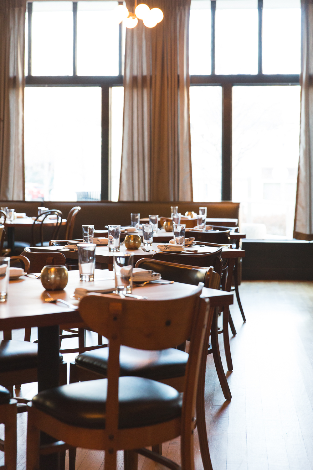 "Your private event or party can be held at Cakes & Ale in one of two beautiful spaces.  From business dinners to bridal showers, we love hosting luncheons and dinner parties for up to 40 people in the main dining room and 15 in our cafe for any type of gathering or event. For information or to book your private event, contact events@cakesandalerestaurant.com. Here's what some of our guests have to say about hosting their private event at Cakes & Ale: ""Please accept my sincere thanks for a wonderful luncheon.  Everything was absolutely perfect, and our staff loved it."" ""We were charmed by absolutely every aspect of the evening. My colleagues in this group are well-traveled and have experienced places such as Chez Panisse, Per Se, etc. I wanted to give them a unique experience with great food and drink without too much fuss. This was perfect!""  ""I just wanted to tell you how amazing the rehearsal dinner was on Friday. I couldn't have chosen a more perfect place.  The layout of the restaurant and bar was ideal for our event as we could finish dinner and then join guests in the bar.  I could not have been more pleased."""