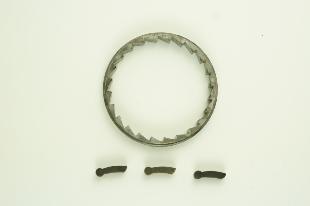 Fig. 1  24 tooth engagement pawls and ratchet ring.  Note:  pawl with one tooth at tip