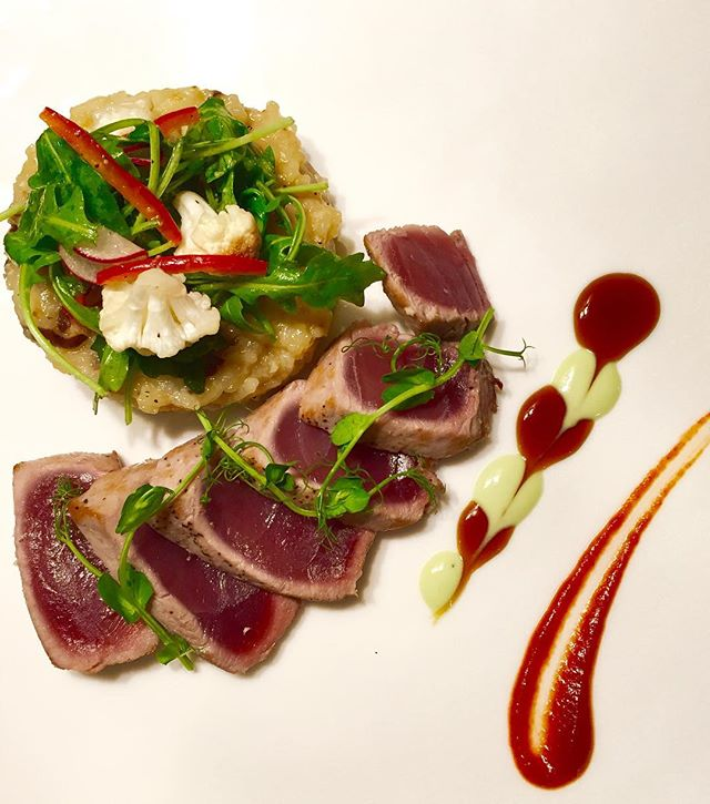Seared Ahi Tuna with a miso shiitake mushroom risotto  topped with a smoked cauliflower salad with a citrus ginger vin.