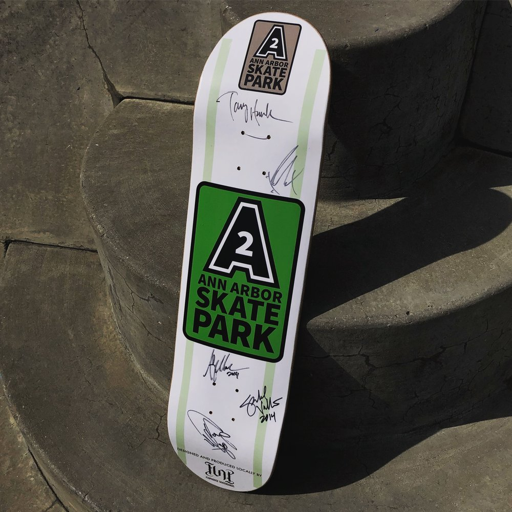 The poster contest winner gets a deck just like this one, signed by Tony Hawk, Andy Macdonald, Alex Sorgente, Tony Magnusson, and Garold Vallie at the Grand Opening of the Ann Arbor Skatepark five years ago!