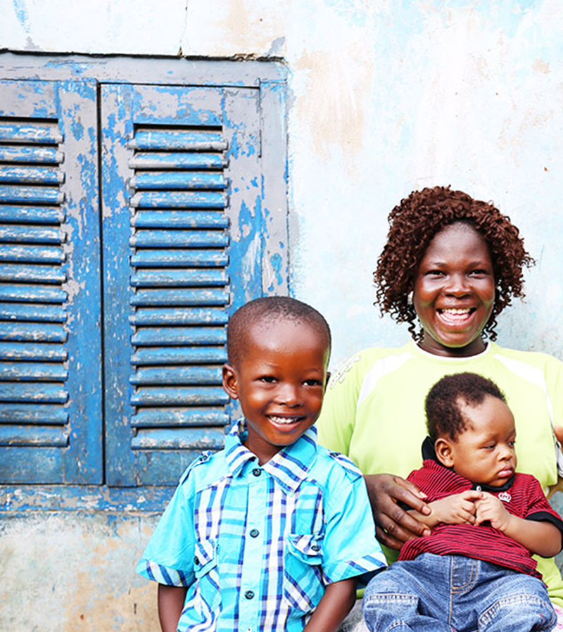 """Mavis, bolga weaver, with her children in Kumasi, Ghana."""