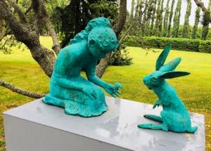 Simonsson, Kim: Girl Feeding a Two Headed Rabbit