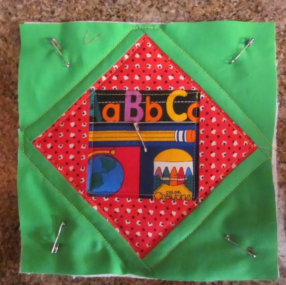 Quilt+potholder+pinned+and+ready+to+sew.jpg