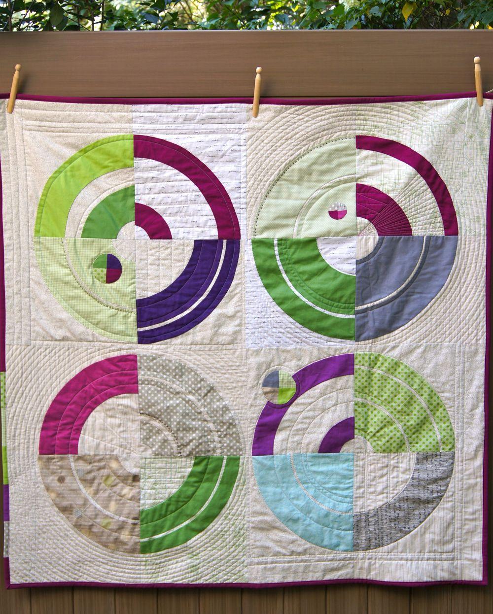 Bulls Eue Quilt, a Carolyn Friedlander Pattern from Savor Each Stitch. 45 x 45 inches