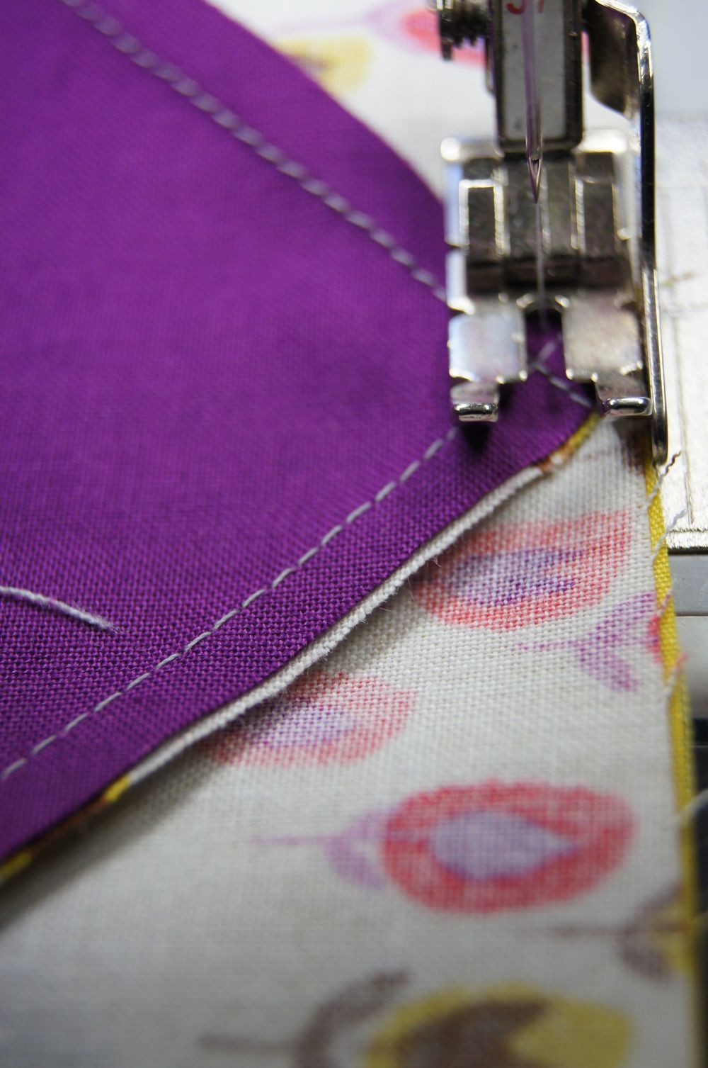 "Sewing across the ""x"" formed by the stitching at the center of the block."