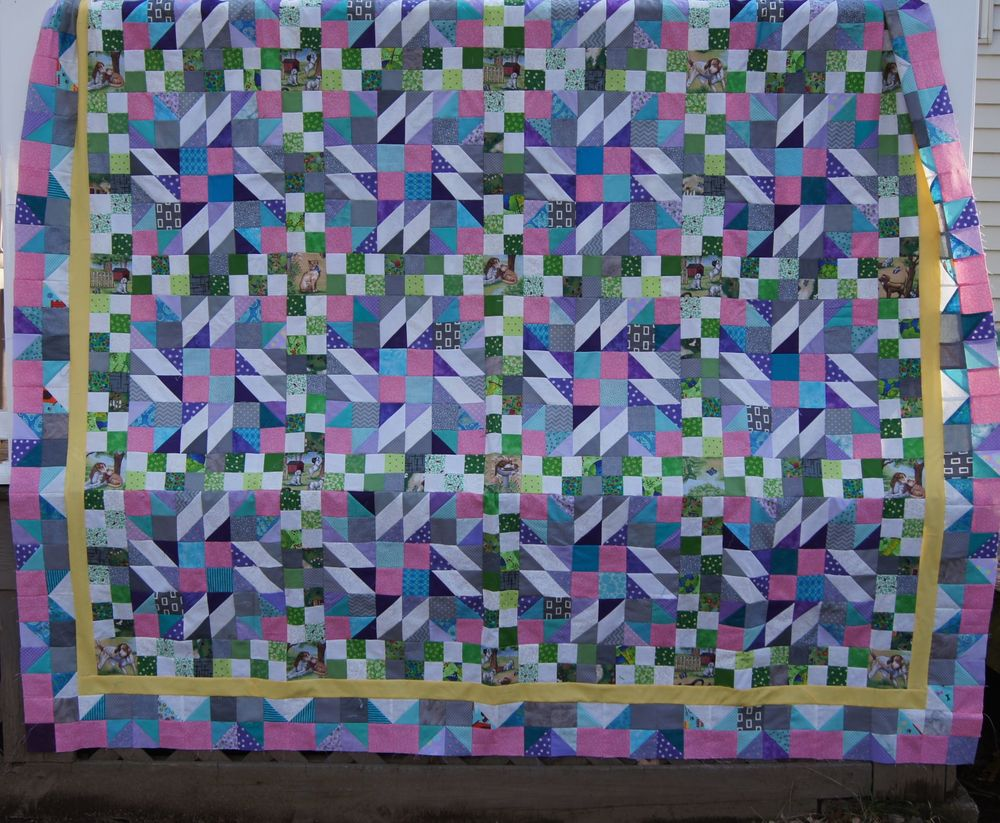 Completed Top--Twin size  74 x 88 inches hanging on the deck railing