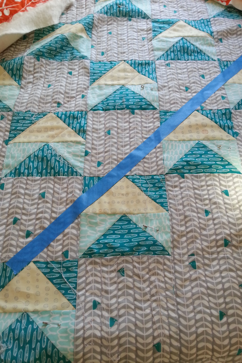 "Painter's tape on the ""Early Birds"" quilt, ready for quilting a long diagonal line"